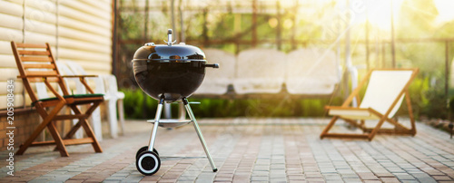 Photo Stands Grill / Barbecue Barbecue Grill in the Open Air. Summer Holidays