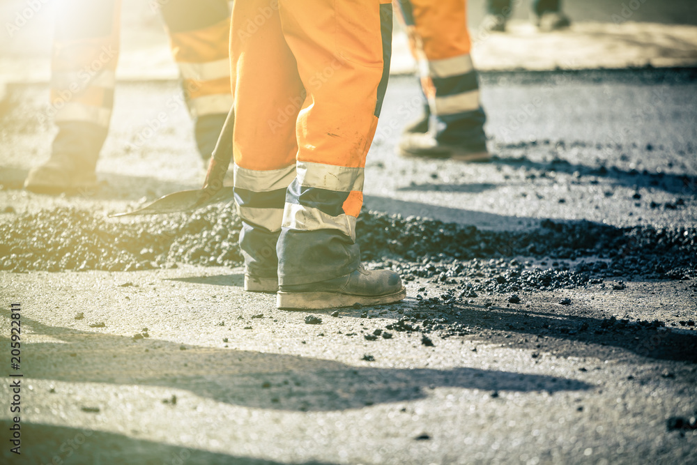 Fototapeta Teamwork on road construction