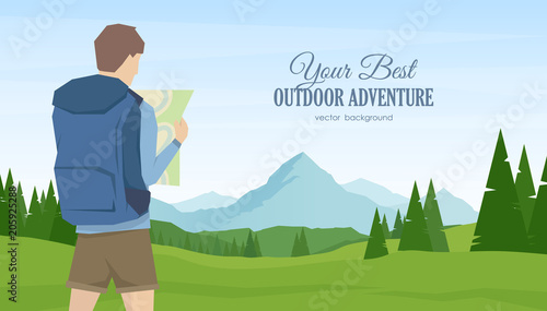 Young man traveler and hiker with map in the hands on summer mountains landscape background