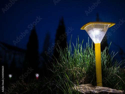 Decorative small yellow solar garden lantern Poster