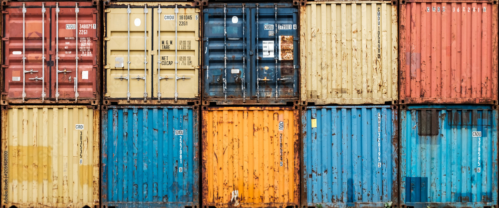 Fototapety, obrazy: Stack of colorful and rusty containers