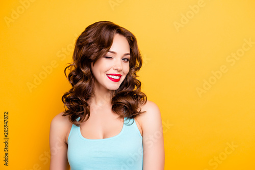 Photo Portrait with copyspace empty place of foxy funny girl with modern hairdo winkin