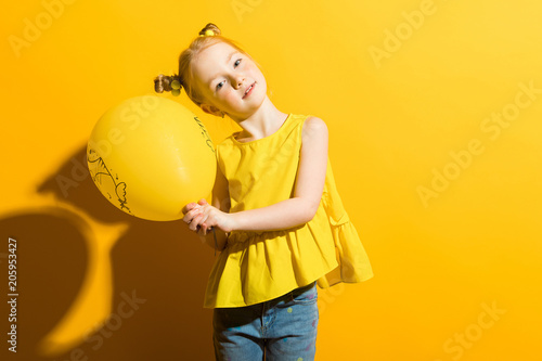 Girl with red hair on a yellow background Poster