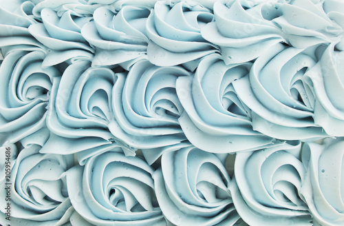 Valokuva  Blue cake icing swirl decoration background pattern.