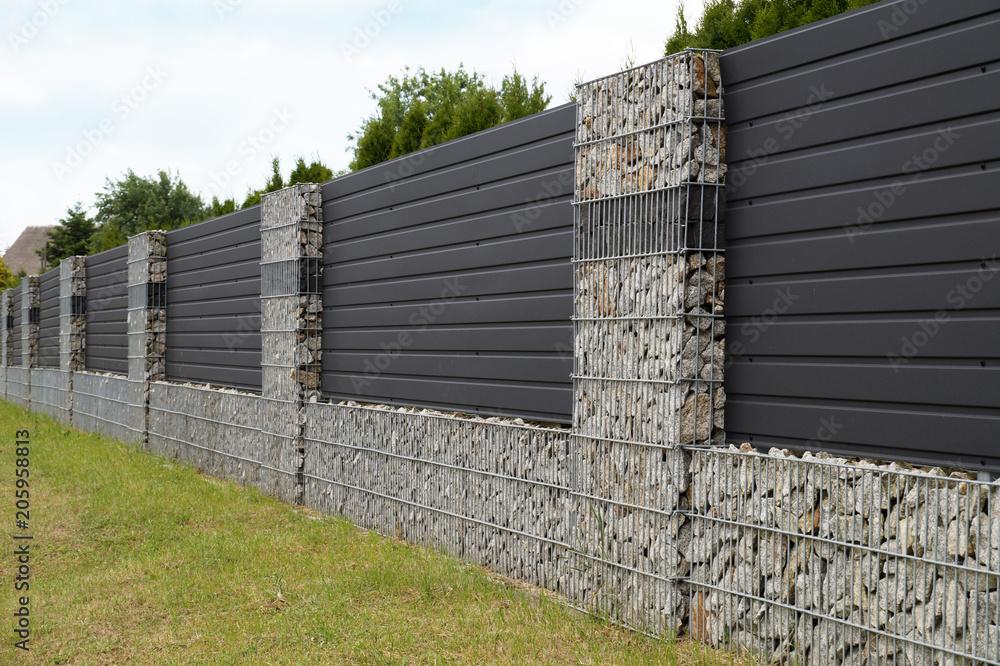 Fototapeta Modern gabion wall.