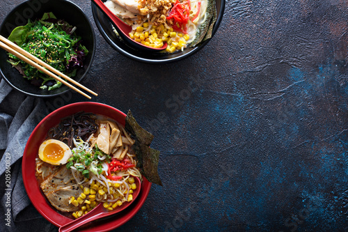 Fotografie, Obraz  Spicy ramen bowls with noodles, pork and chicken