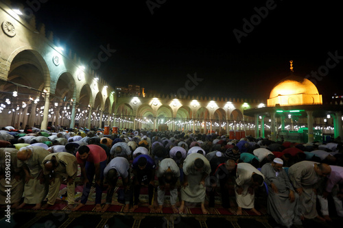 Egyptian Muslims perform evening prayers called