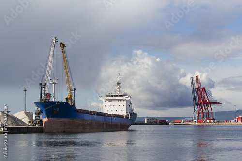 Foto op Canvas Poort Moored vessel on commercial harbor