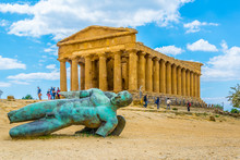 Statue Of Fallen Icaro In Front Of The Concordia Temple In The Valley Of Temples Near Agrigento In Sicily, Italy