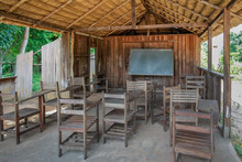 Wooden School And Straw Roof In A Village In The Brazilian Amazon.