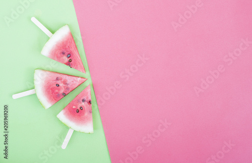 three watermelon slices on red background