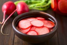 Fresh Radishes Cut In Thin Slices Pickled In Red Wine Vinegar With Sugar And Salt, Photographed With Natural Light (Selective Focus, Focus On The Front Of The Radish Slice On The Top)
