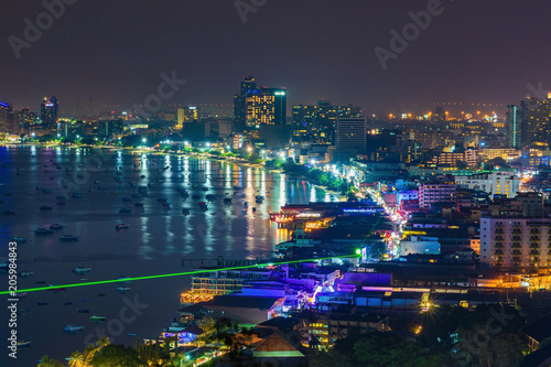 Deurstickers Stad gebouw Pattaya city and the many boats docking at night