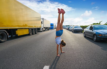 Hand Stand Girl In A Traffic J...