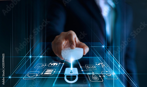 Data protection concept. GDPR. EU. Cyber security. Business man using mouse computer with padlock icon and internet technology network on blue background.