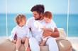 happy family enjoying summer vacation at the sea beach