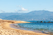Beautiful seascape, the coast of the island of Corsica, the beach in Ajaccio. Yellow sand, hills and blue sea
