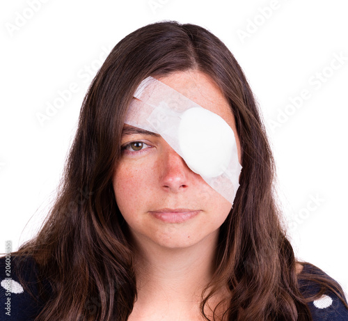 Fotografie, Tablou Portrait of woman wearing eye patch as protection after injury