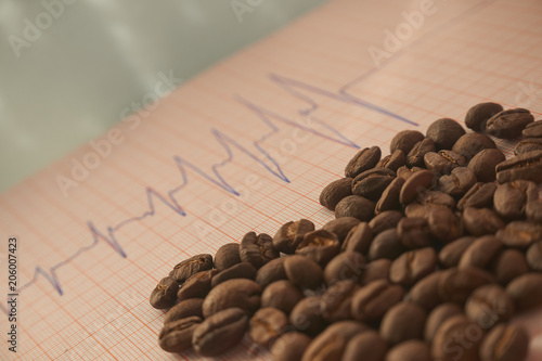 Fotografie, Obraz  Loose roasted coffee beans on an ECG tracing