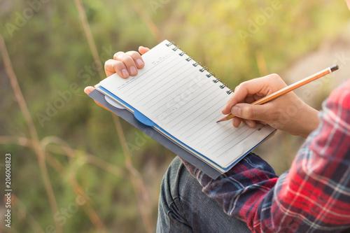 Deurstickers Women writers take note of nature studies.