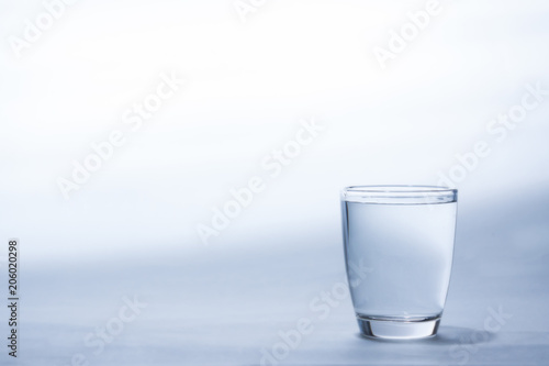 Water in glass on white background