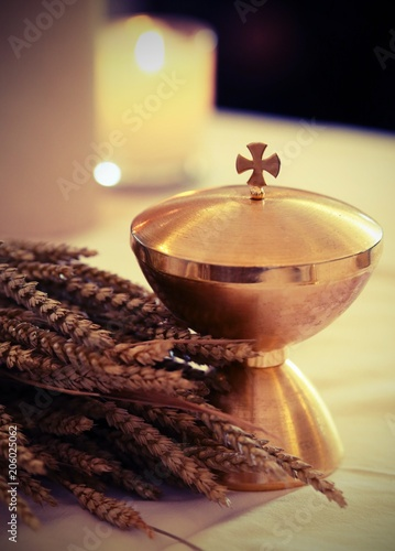 Vászonkép wheat and the golden chalice on an altar in a church