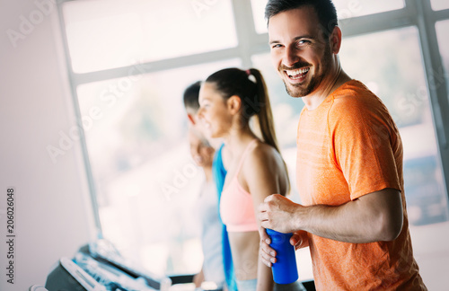 Fotografie, Obraz  Picture of people running on treadmill in gym
