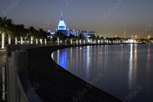 Photo  Dubai, United Arab Emirates - May 21, 2018: Dubai Silicon Oasis Headquarters Building with Lake view at night, Established in 2014 a free zone owned by the Government of Dubai