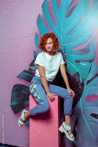 7f2b178e64 Beautiful sexy red hair smiling woman wearing high waist jeans and white t- shirt