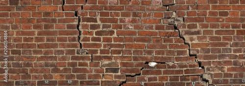 Fototapeta The cracks in an old brick wall. Texture obraz