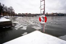 Harbor In Frozen River