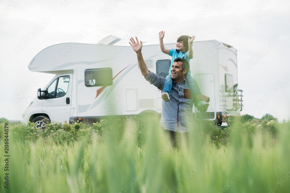 Fototapety, obrazy: Father and son with the holiday caravan