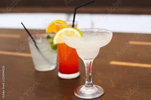 Deurstickers Cocktail Cocktail glasses on wooden background