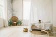 Leinwandbild Motiv Sunny Skandinavian style interior bedroom. Wooden floor, natural materials, dog pug sitting on the bed