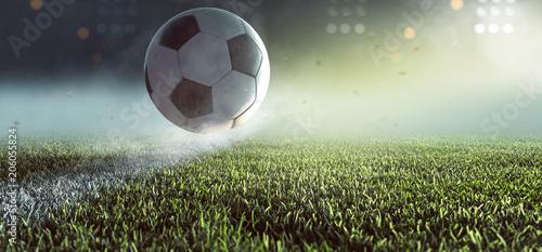 fototapeta na szkło Fußball springt auf Linie