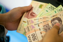 Hands Counting Mexican Money