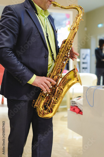 musician plays the saxophone performance at a concert in shopping center of wome Canvas Print