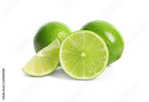 Fresh ripe green limes on white background