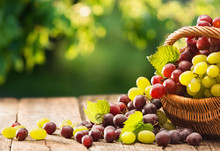Grapes In A Basket On A Wooden...