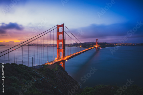 Fotografering  The Golden Gate Bridge at Dawn