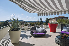 Exteriors Shots Of A Modern Terrace With Awnings And Sofas
