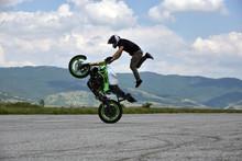 Stunt Motorcyclist In Action