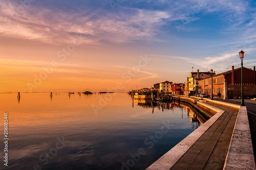 Foto auf Leinwand Rotglühen Romantic sunset on the Venice lagoon. Island of Pellestrina.