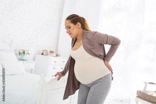 Discomfort during pregnancy Wallpaper Mural
