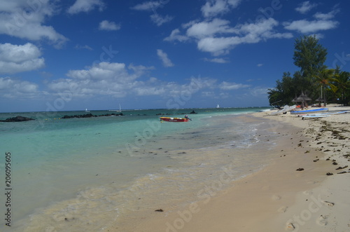 Printed kitchen splashbacks Zanzibar Turquoise water and a white sandy beach with a blue sky and a red boat