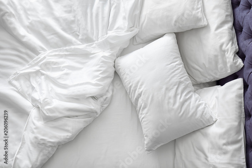 Obraz Comfortable bed with white linen at home - fototapety do salonu