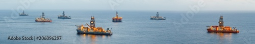 offshore oil platform and gas drillship with illumination, panoramic view