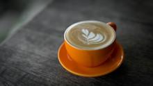 Hot Latte Coffee In Orange Cup