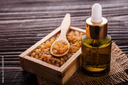 Obraz na plátně frankincense essential oil on a wooden background