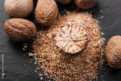 Obraz na plátně aromatic nutmeg on a dark stone background